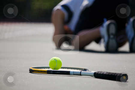 Sad tennis player after defeat stock photo, A shot of a sad tennis player after a defeat by Suprijono Suharjoto
