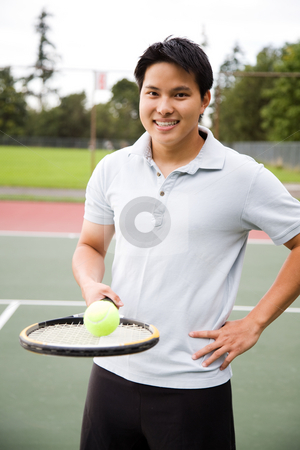 Asian tennis player stock photo, A young sporty asian male playing tennis by Suprijono Suharjoto