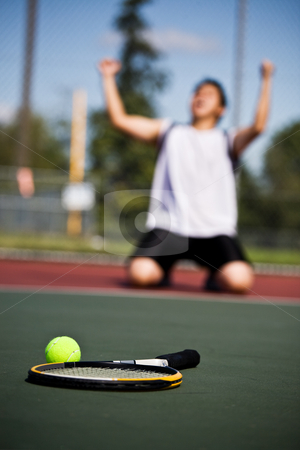 Winning tennis player stock photo, A happy tennis player in joy after winning by Suprijono Suharjoto