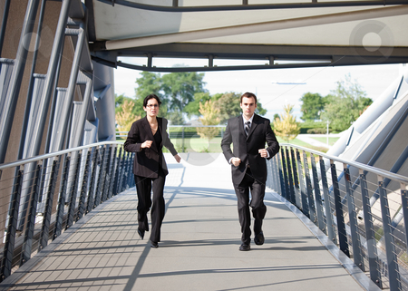 Business people in running competition stock photo, A shot of two business people running competing against each other by Suprijono Suharjoto