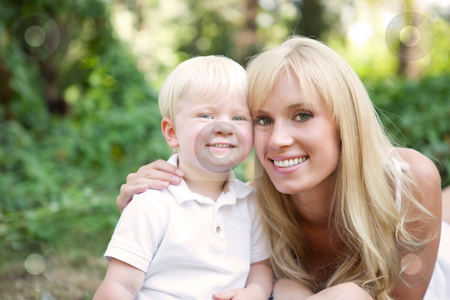 Happy caucasian mother and son stock photo, A portrait of a happy caucasian mother with her son outdoor by Suprijono Suharjoto