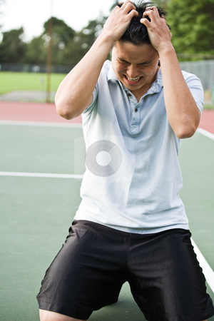 Disappointed tennis player stock photo, An asian tennis player disappointed in defeat after a tennis match by Suprijono Suharjoto