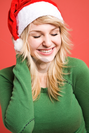 Happy santa girl stock photo, A beautiful happy caucasian girl wearing santa hat during christmas by Suprijono Suharjoto