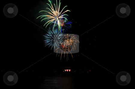 Fireworks In A Rainbow Of Colors stock photo, Colorful nighttime fireworks against a solid black sky over Lake Tahoe on the fourth of July holiday 2010 by Lynn Bendickson