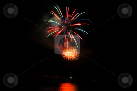 Red And Green Fireworks stock photo, Colorful nighttime fireworks against a solid black sky over Lake Tahoe on the fourth of July holiday 2010 by Lynn Bendickson