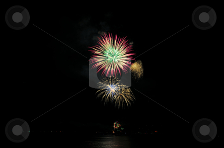 Pink Gold And Green Fireworks stock photo, Colorful nighttime fireworks against a solid black sky over Lake Tahoe on the fourth of July holiday 2010 by Lynn Bendickson
