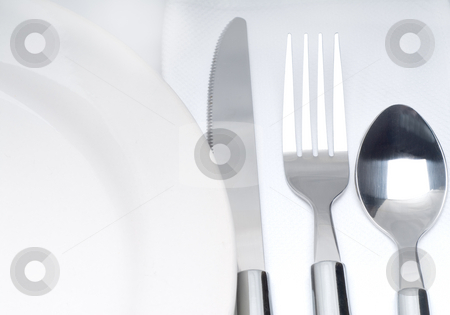 Cutlery set on a table stock photo, Close up of a cutlery set on a table with napkin and dish by Francesco Perre