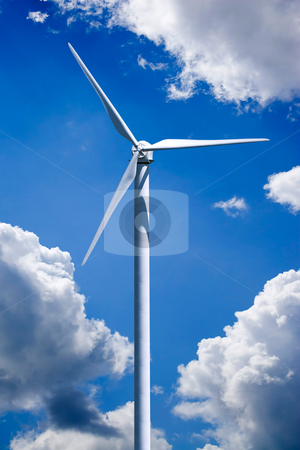 Wind Turbine Power Generation stock photo, A single wind turbine over a cloud filled blue sky.  Clipping path is included for easy isolation of the turbine. by Todd Arena