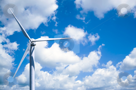 Wind Turbine Power Generation stock photo, A single wind turbine over a cloud filled blue sky. by Todd Arena