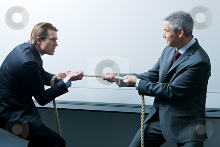 Business People stock photo, Businessmen pulling on opposite ends of rope by Alexander Beck