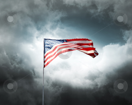 American flag on a cloudy dramatic sky stock photo, American flag on a dark cloudy dramatic sky by Laurent Davoust