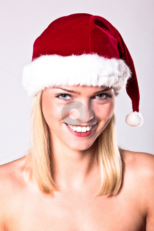 Sexy Santa Blond Girl stock photo, Portrait Of A Sexy Blond Girl Wearing A Santa Hat by Nick Fingerhut