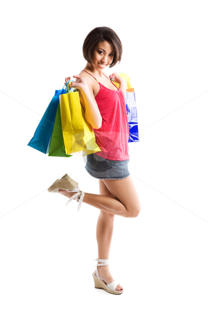 Shopping woman stock photo, An isolated shot of a beautiful black woman carrying shopping bags by Suprijono Suharjoto
