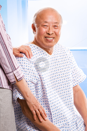 Senior asian healthcare stock photo, A shot of a happy senior asian male accompanied by his wife in the hospital by Suprijono Suharjoto