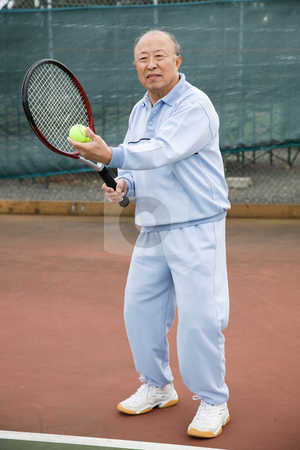 Senior tennis player stock photo, A shot of a senior asian man playing tennis by Suprijono Suharjoto