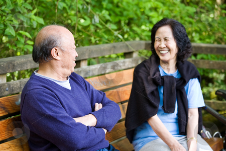 Happy mature couple stock photo, A happy mature asian couple having fun and laughing outdoor by Suprijono Suharjoto
