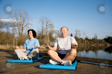 Senior couple exercise stock photo, A shot of a senior asian couple practicing yoga and meditating by Suprijono Suharjoto