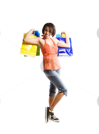 Shopping woman stock photo, An isolated shot of a happy african american woman shopping by Suprijono Suharjoto