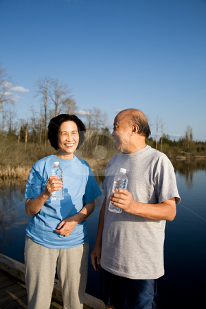 Senior asian couple stock photo, A shot of a happy senior asian couple chatting after a workout by Suprijono Suharjoto