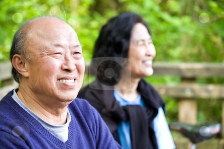 Happy senior asian couple stock photo, A shot of a couple of happy asian senior outdoor by Suprijono Suharjoto
