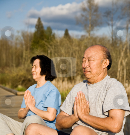 Active senior asian couple stock photo, An active senior asian couple exercises and practices yoga and meditation by Suprijono Suharjoto