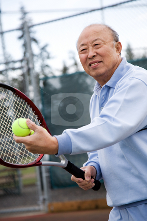 Senior tennis player stock photo, A shot of an senior asian man playing tennis by Suprijono Suharjoto