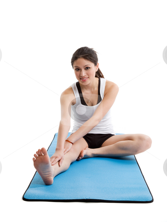 Asian woman exercise stock photo, An isolated shot of a beautiful asian woman warming up before exercising by Suprijono Suharjoto