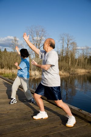 Senior exercise stock photo, A shot of a senior asian couple practicing taichi exercise by Suprijono Suharjoto