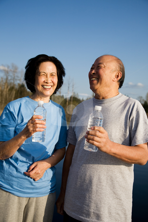 Fun senior asian couple stock photo, A shot of a senior asian couple having fun outdoor by Suprijono Suharjoto