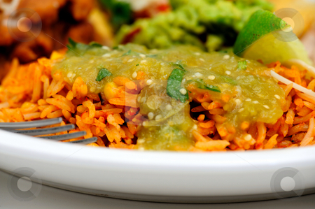 Spanish Rice And Salsa stock photo, Spanish rice close-up with salsa verde made with tomatillo jalapeno garlic and cilantro poured over the top by Lynn Bendickson