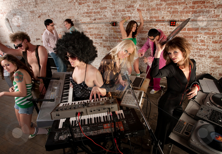 1970s Disco Music Party Fun stock photo, Female DJs Rocking a Disco Music Party by Scott Griessel