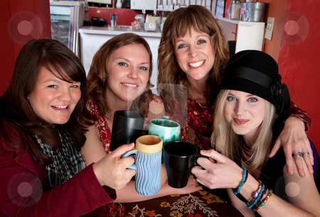 Friends Four-Ever stock photo, Four young happy female friends at a cafe by Scott Griessel