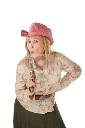 Cowgirl on white background with a recently used pistol stock photo, Woman with pink cowboy hat with a recently used pistol by Scott Griessel