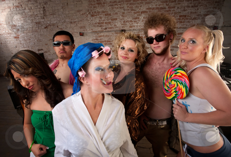 Eccentric woman hanging out with party kids stock photo, Lady dancing with a very young group at a 1970s Disco Music Party by Scott Griessel