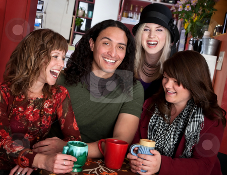 Four friends stock photo, Four laughing friends enjoying coffee in a cafe by Scott Griessel