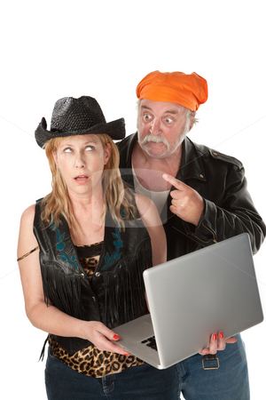 Woman ambarrased by the contents of her laptop stock photo, Couple bickering over things on their laptop computer by Scott Griessel