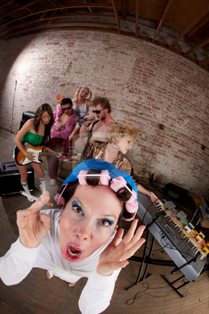 1970s Disco Music Party stock photo, Very upset woman with curlers at a 1970s Disco Music Party by Scott Griessel