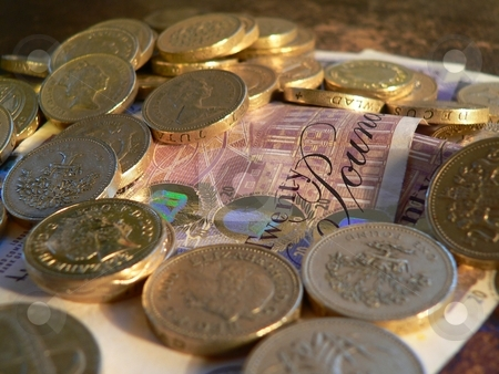 Pounds and sterling stock photo, Pounds scattered on twenty pounds notes  Uk sterling money notes and coins by Casinozack