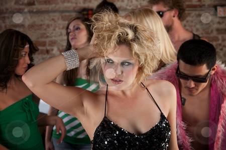 1970s Disco Music Party stock photo, Lovely blond with hands running through her hair at a party by Scott Griessel