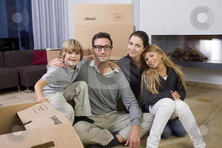 New Home stock photo, Portrait of a Family lying in front of Cardboard Boxes by Alexander Beck