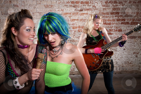 Female punk rock band stock photo, Young all girl punk rock band performs in a warehouse by Scott Griessel