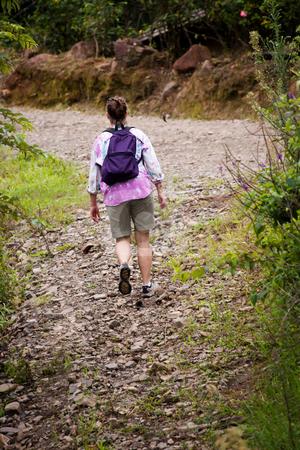 Hiker in Costa Rica stock photo, Female hiker on a rugged trail in Costa Rica by Scott Griessel