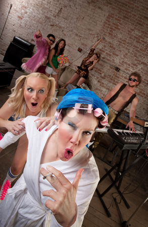Wild Neighbor stock photo, Wild neighbor acting foolishly with young partygoers by Scott Griessel