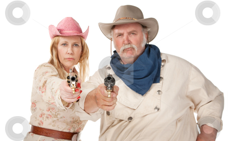 Gunslingers stock photo, Gunslingers western wear pointing pistols and laughing by Scott Griessel