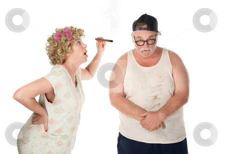 Nagging wife stock photo, Bickering wife with cigar confronting husband on white background by Scott Griessel