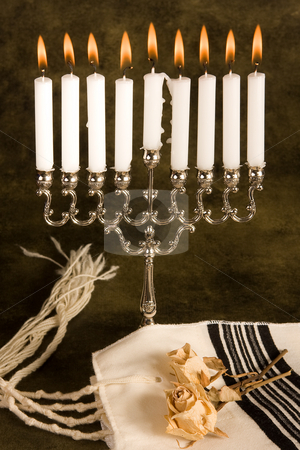 Prayer shawl and hanukkah stock photo, Hanukkah candle-holder and a jewish prayer shawl by Anneke