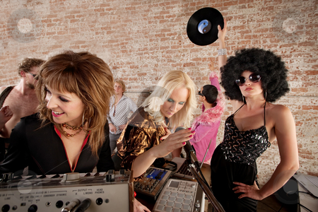 1970s Disco Music Party stock photo, Three female DJs performing at a 1970s Disco Music Party by Scott Griessel