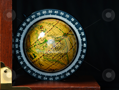Globe Book End stock photo, A bookend in the shape of a world globe, shot against a dark background by Richard Nelson