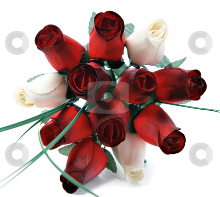 Wooden Roses stock photo, A bouquet of a dozen roses that are made of wood, isolated on a white background. by Richard Nelson