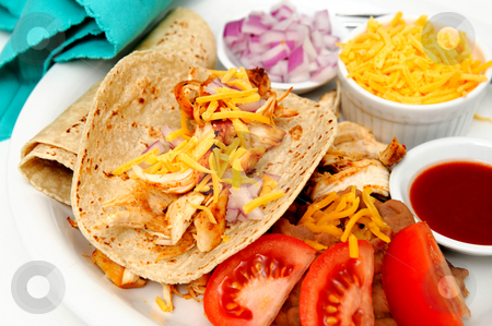 Spicy Chicken Tacos stock photo, Spicy white meat chicken taco with red onion, cheddar cheese, sliced tomatoes and a small bowl of red hot suace by Lynn Bendickson